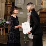 KFF Vilnius office director Agne Vertelkaite presents dr. Rita Miliunaite with the Award