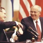 US President George Bush shakes hands with Soviet President Mikhail Gorbachev at the conclusion of their joint news conference ending the one day summit in Helsinki, Finland, September 1990. / AP